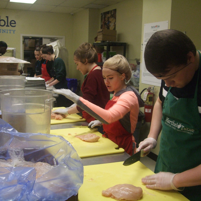 GSL students at Martha's Table, Washington DC, preparing lunch for the many homeless