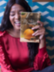 happy-black-woman-holding-a-book-mockup-