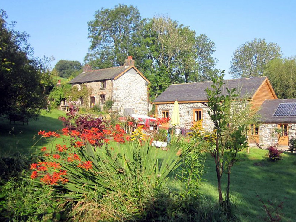Barn and farmhouse in beautiful gardens