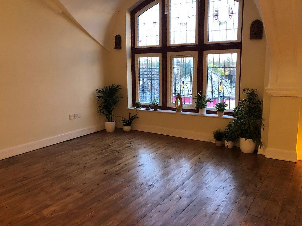 Studio Yoga Classes with photo of studio windows