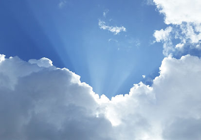 Photo of sky with clouds with sun rays
