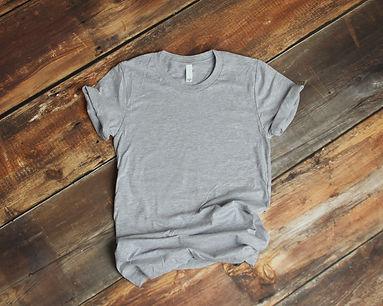 Mockup of blank gray tshirt on rustic wo
