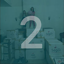 Circlular image of two girls standing on top of stacked moving boxes in warehouse with a blue overlay and white number 2 over top.