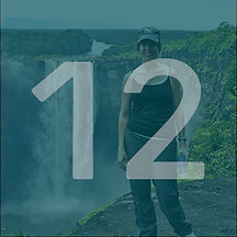 Circlular image of woman in hat with waterfall in background with a blue overlay and white number 12 over top.