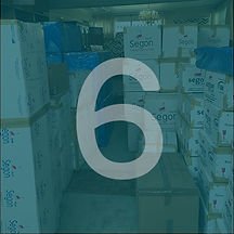 Circular image of stacked moving boxed in a room with a blue overlay and white number 6 over top.