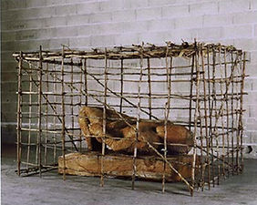technique: sculpted mahogany and pygmy hunting shelter, created in the primary forest of the Central African Republic, part of body of work dealing with forest divinities and the rapprochement with the self