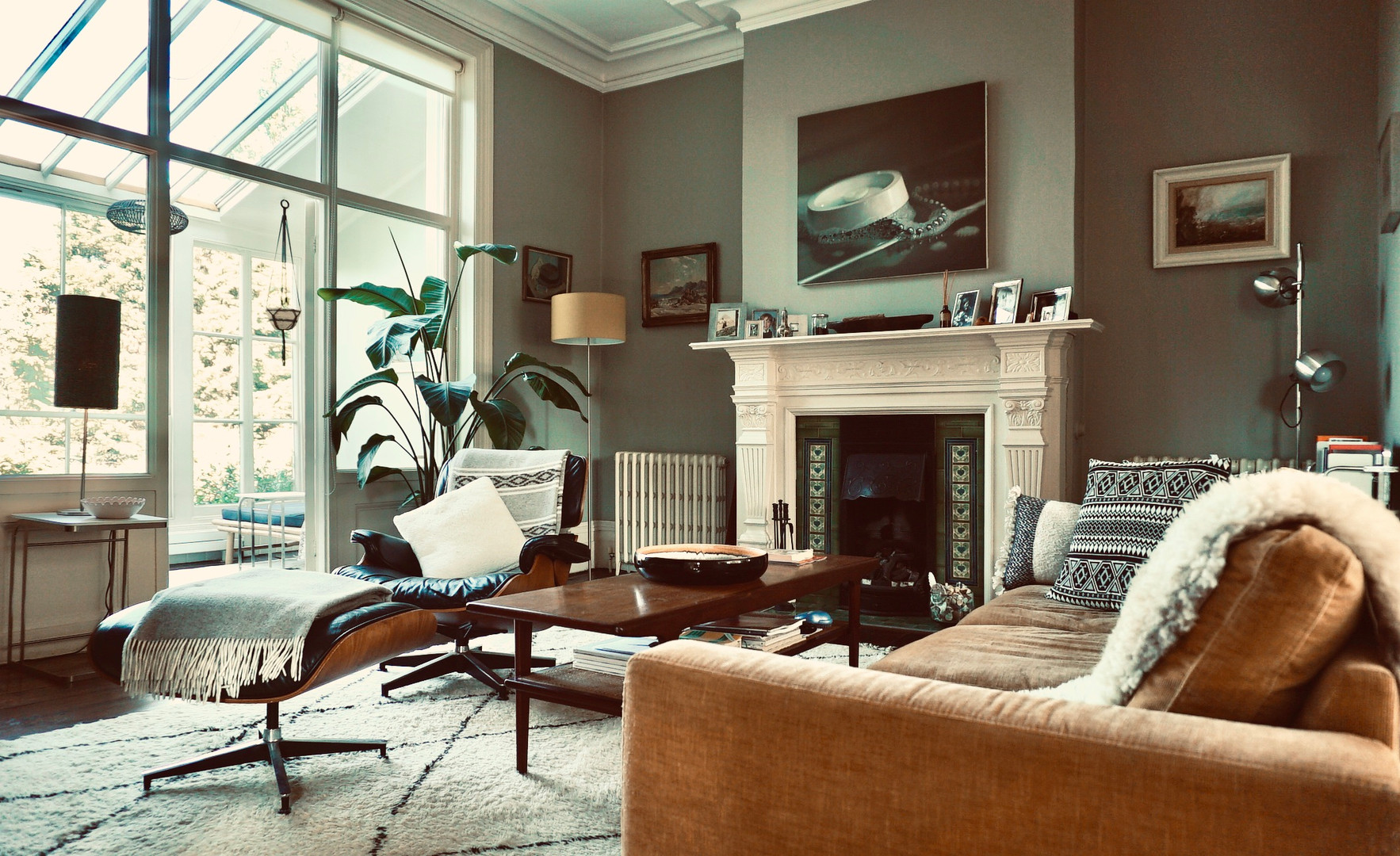 Living room interior in Hardwick White. Sourced period furniture, artwork and soft furnishings.