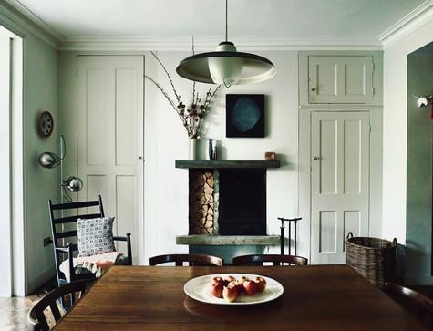 North London House dining room. Cast in situ concrete fireplace, Danish period furniture.