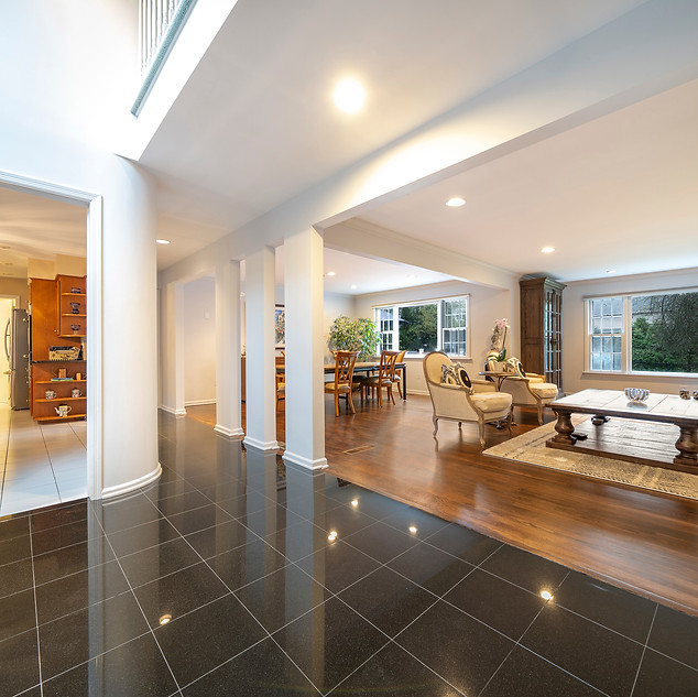 Foyer into open living and dining rooms