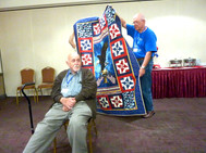 Larry Robbins receiving his Quilt of Valor for his long distinghed service