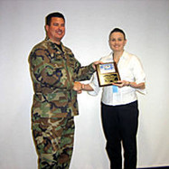 Lt. Col Vaughn & his worker Kelly Rhodes received a Plaque for the help she provided our group in Iceland