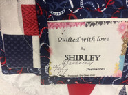 The quilt was hand stiched by Shirley Berkeley