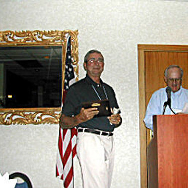 David Hawk receiving a plaque of Appreciation from William Chick