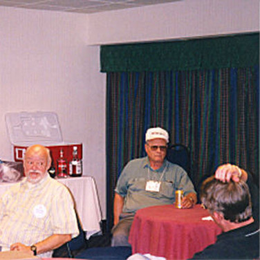 Don J. Schurtz, Roger Nasvs & Cameron Davis met in the Hospitality Suite