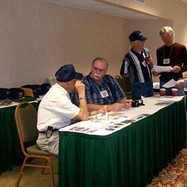 Homer Guernsey & Jerry May's turn at the Registration Desk