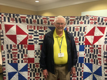 Col. Doug Harper was wrapped in a Quilt of Valor for his long time well respected service to our country