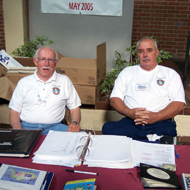 """Pappy"" Papworth & Michael Mangone took their turn at the Registration Deskjpg"