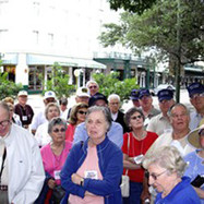 Members and guests listening to our tour guide at the Alamo