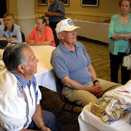 Joseph Starenchak & Darold Allen sharing a table in the Hospitality Suite