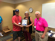 Presenting Katherine Charlton, Mgr of the Fairfield Inn with our Plaque of Appreciation