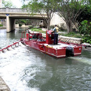 This boat cleans the river to keep it looking beutiful