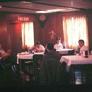 1968-SP-004-chow_hall-preacher_on_left 1