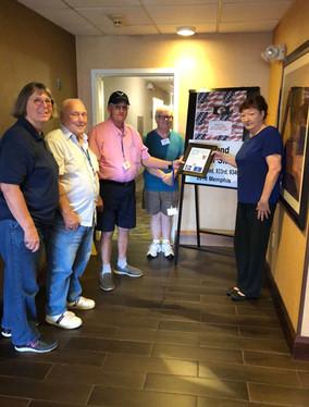 Teresa Smoot , Hampton Inn Mgr receiving Plaque of Appreciation