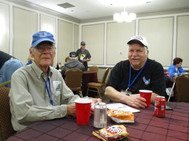 A few of the veterans snacking and remiinissing