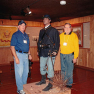 """Two """"civies"""" flank a uniformed soldier from back in time"""