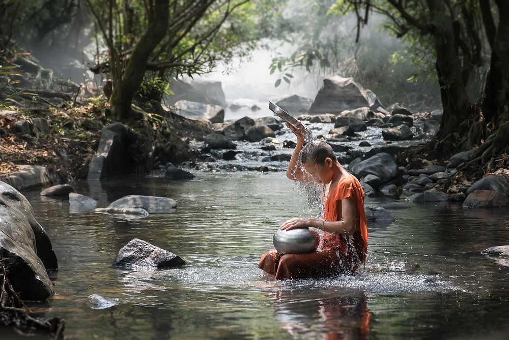 monk in water worship