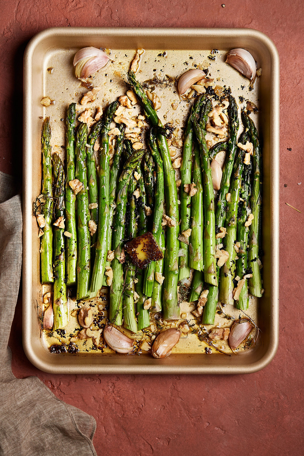 Asparagus with Brown Butter Cubes and Garlic Cloves - cooked