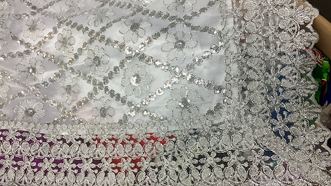 Metallic fabric & trim with satin backing