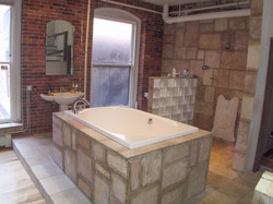 Soaking Tub dominates open bathroom