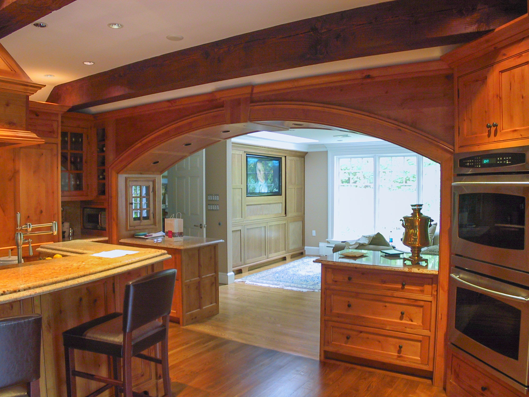 Arched opening into family room