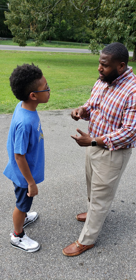Mr. Bowen talking with a student