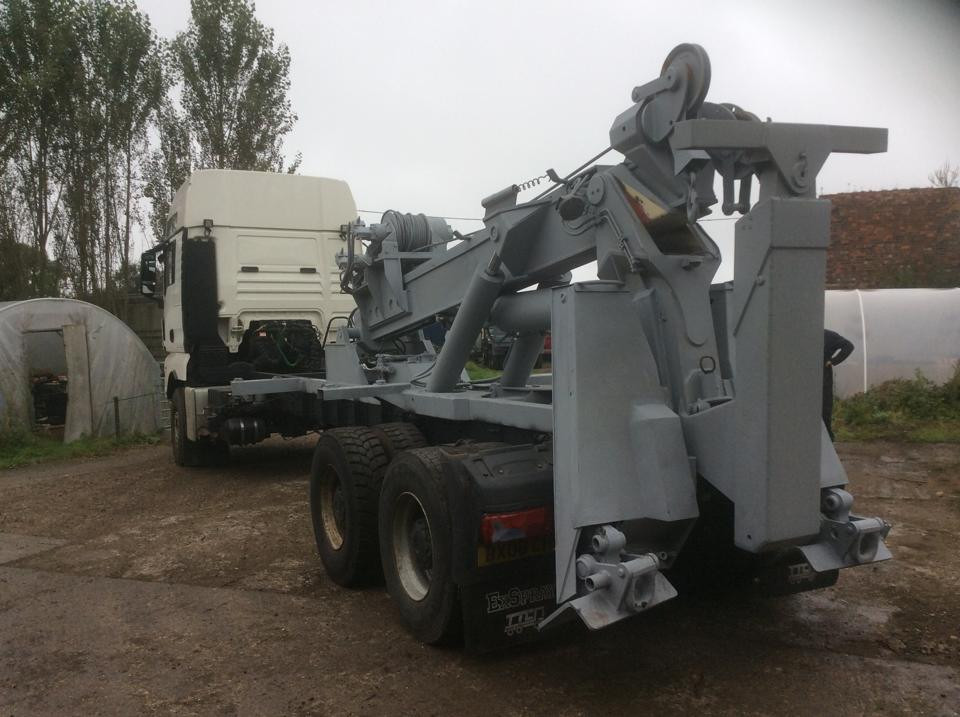 man tga tow truck for sale
