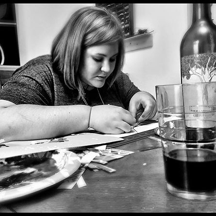 Hard at work with wine of course!