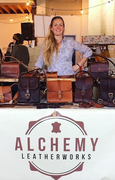 Nixy with a selection of handcrafted leather goods at Fresh Artisan Market, Norwich.