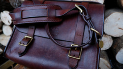 My friends well used and loved satchel, now with his late dog Nelsons collar incorporated into the s