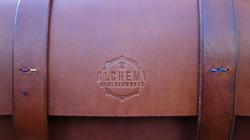 Alchemy Leatherworks embossed logo on chestnut