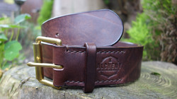 2 inch wide chocolate belt, with cast brass single roller buckle, dark brown stitching