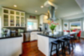 Empty Simple Old Kitchen With Hardwood Floor And White Cabinets.jpg