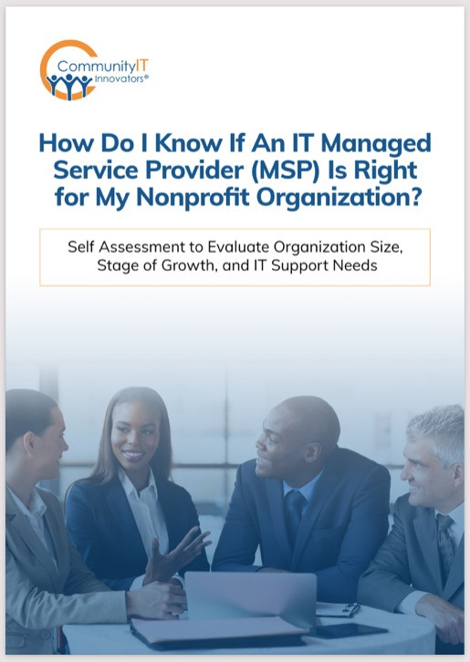 """Professionals collaborating at a table. Above them, there is text. It reads, """"How Do I Know If An IT Managed Service Provider Is Right for My Nonprofit Organization?"""""""