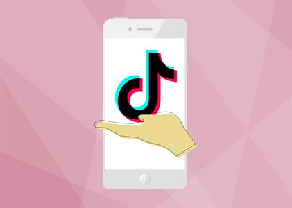 hand holding tiktok note logo over phone pink background nonprofit