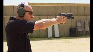 man firing pistol.jpg
