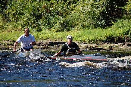 K-1 and C-1 paddlers descend rapids on the Oswegatchie River during the 2017 Remington II race, Rensselear Falls to Huevelton, NY