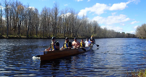 Wounded Warriers team paddle a voyager canoe at 2016 Canton Canoe Weekend