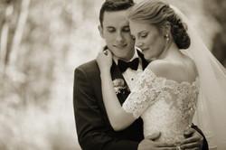 Bride and groom in gentle embrace