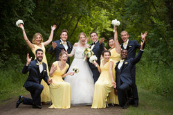 Fun bridal party throwing hands up in the air