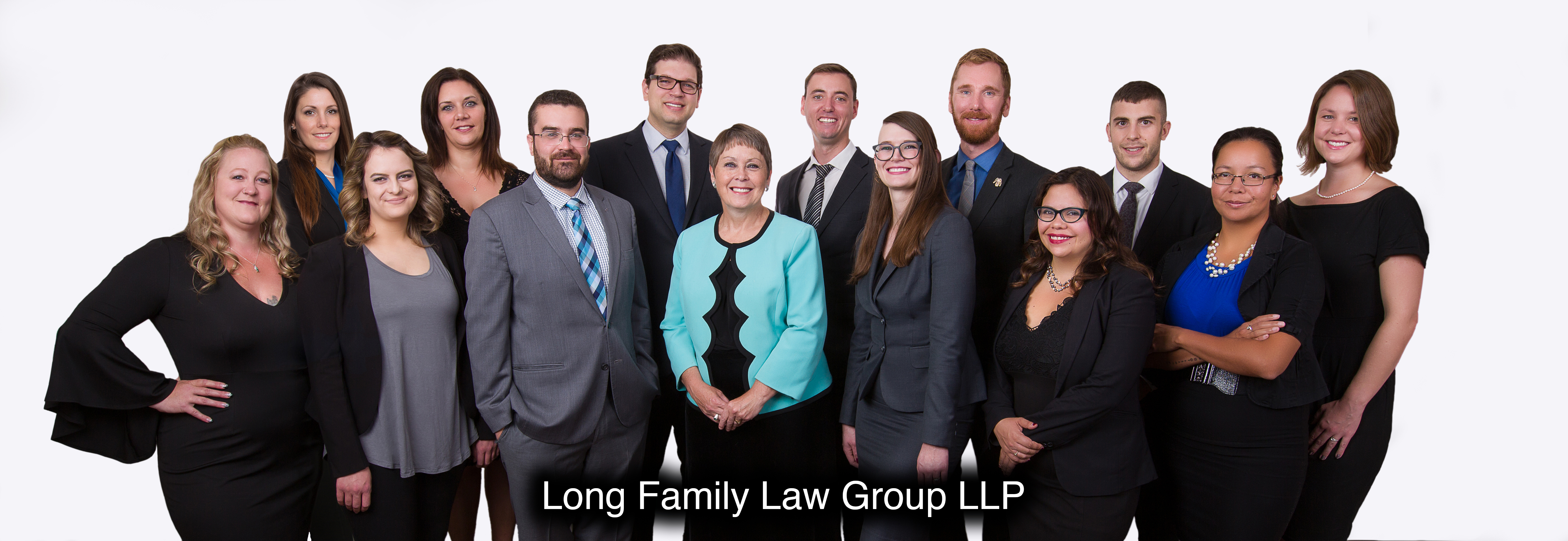Group of lawyers and assistants in front of a white background